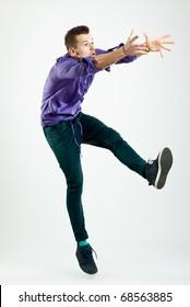 handsome young man model jumping  - studio shot