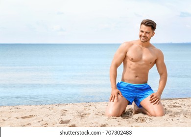 Handsome young man on sea beach