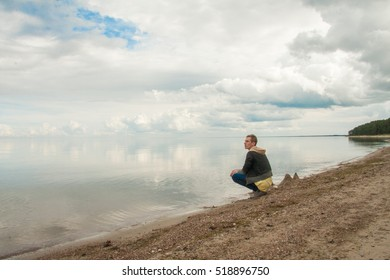 Handsome young man on the seashore in Latvia