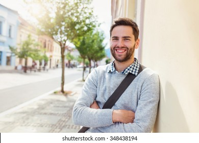 Handsome young man on a walk in town