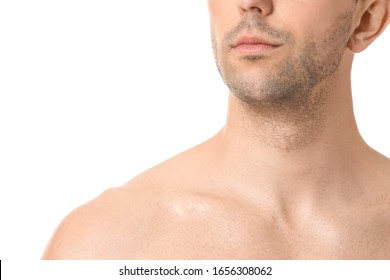 Handsome young man on white background, closeup. Plastic surgery concept