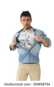 Handsome young man opening shirt on chest like a superhero, isolated