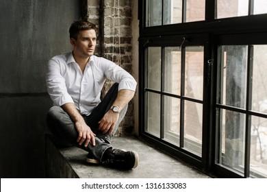Handsome young man in original loft interior