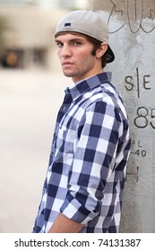 Handsome young man in an outdoor downtown urban fashion pose.