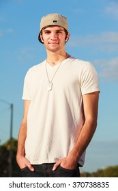 Handsome young man outdoor fashion portrait