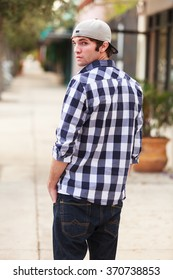 Handsome young man outdoor fashion portrait.