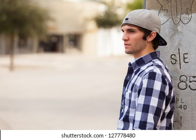 Handsome young man outdoors in a downtown urban setting.
