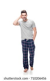 handsome young man in pajamas isolated on white