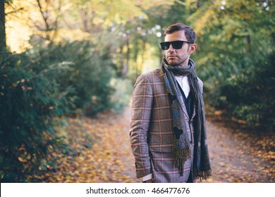 Handsome young man in park, autumn