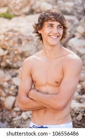 Handsome young man portrait on rocks background