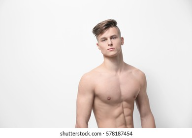 Handsome young man posing on white background