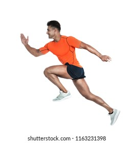 Handsome young man running on white background