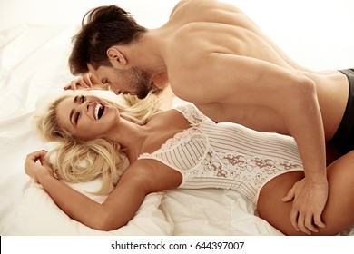 Handsome young man seducing the pretty blond lady