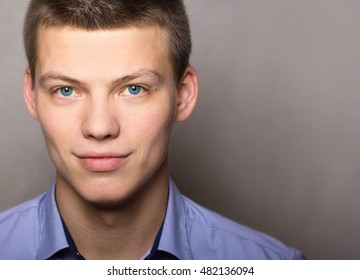 a handsome young man in a shirt - businessman