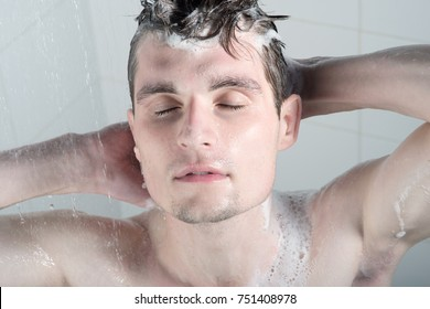 Handsome young man in shower