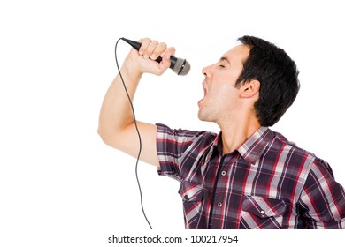 handsome young man singing to the microphone, isolated on white