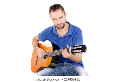 handsome young man singing and playing the guitar isolated in white background