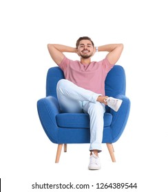 Handsome young man sitting in armchair on white background