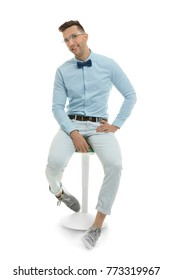 Handsome young man sitting on stool, isolated on white