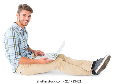 Handsome young man sitting using laptop on white background