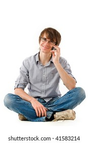 Handsome young man smiling and holding mobile phone