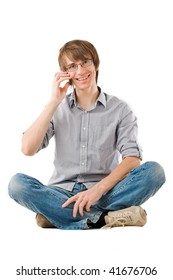 Handsome young man smiling and talking by mobile phone. Isolated over white