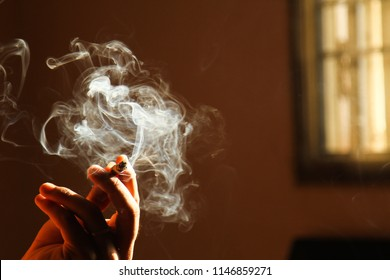 Handsome young man smoking