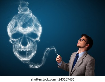 Handsome young man smoking dangerous cigarette with toxic skull smoke