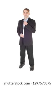 c323890ba68 A handsome young man standing from the front is a dark suit and blue shirt  fixing