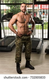 Handsome Young Man Standing Strong In Army Pants And Flexing Muscles - Muscular Athletic Bodybuilder Fitness Model Posing After Exercises