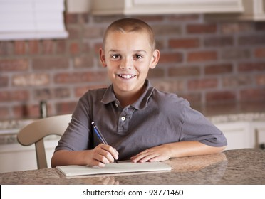 Handsome young man studying and writing