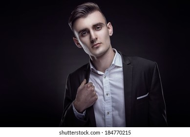 Handsome young man in stylish jacket. Office worker. Successful businessman