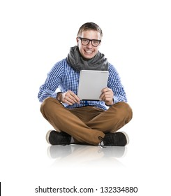 Handsome young man with tablet isolated in studio