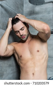 handsome young man taking shower in morning