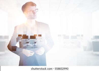 Handsome young man thinking about employment. Double exposure