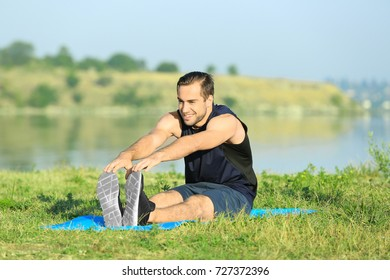 Handsome young man training outdoors