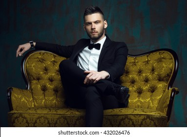 Handsome young man in a tuxedo looking at the camera. Fashionable Clothing. Clothing for the festive evening. Evening tuxedo. Fashion look