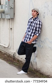 Handsome young man in a urban fashion pose in a downtown area.