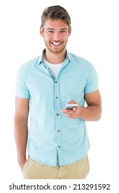 Handsome young man using his smartphone on white background