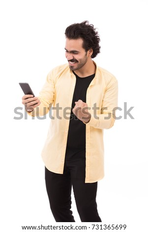yellow shirt and black pants