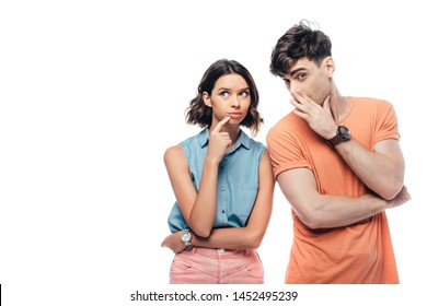 handsome young man whispering to thoughtful woman and looking at camera isolated on white