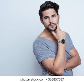 handsome young man with wrist watch