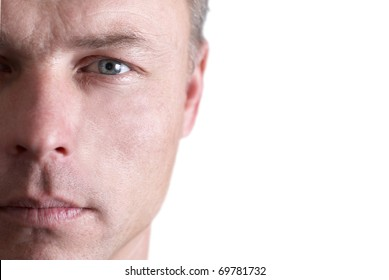 Handsome young man's face. Close up portrait on white background
