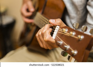 Handsome young men playing guitar