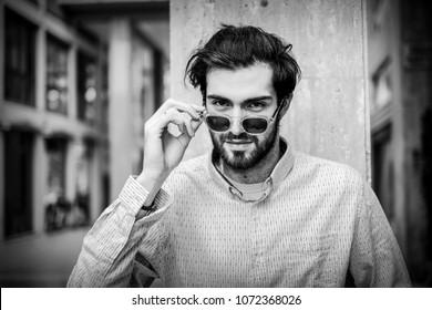 handsome young men pose for street fashion in reggio emilia italy