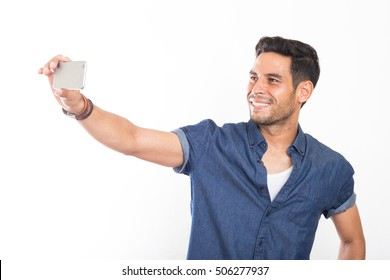 handsome young men taking a selfie on his cellphone. isolated on white background
