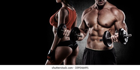 Handsome young muscular couple exercising with dumbbells