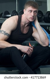 Handsome young muscular sports man in gymnasium