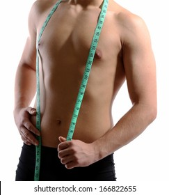 Handsome young muscular sportsman with measuring tape, isolated on white