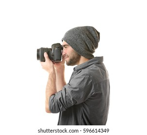 Handsome young photographer on white background